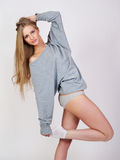 Blonde girl wearing underwear and grey sweater Royalty Free Stock Images