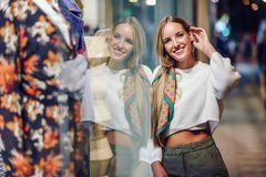 Blonde girl smiling with defocused urban city lights at night stock photos