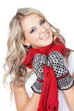 Blonde girl wearing winter clothing over white Royalty Free Stock Photos