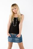 Blonde girl on white. In jeans royalty free stock photo