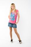 Blonde girl on white. In jeans royalty free stock image