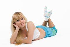 Blonde girl on white. Sport blonde girl on white royalty free stock photos