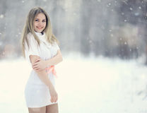 Blonde girl in white dress at winter forest Royalty Free Stock Photos