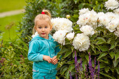 Blonde girl with white peonies Stock Image