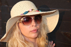 The blonde girl wiht sunglases, in the hat Stock Photos