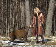 Blonde girl with wild boar Royalty Free Stock Images