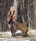 Blonde girl with wild boar Royalty Free Stock Photos