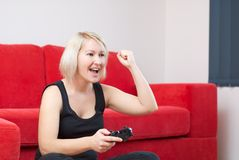 Blonde girl is winning at video games Stock Photography