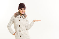 Blonde Girl In Winter Clothes, With Outstretched Palm Royalty Free Stock Image