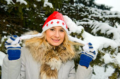 Blonde girl in winter forest stock images
