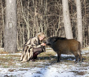 Blonde Girl With Wild Boar Royalty Free Stock Photography