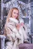 Blonde girl in wooden chair Royalty Free Stock Images