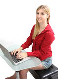 Blonde girl working on a computer Royalty Free Stock Images