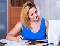 Blonde girl working with documents Royalty Free Stock Images