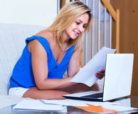 Blonde girl working with documents Stock Photos