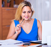 Blonde girl working with documents Royalty Free Stock Photo