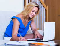 Blonde girl working with documents Royalty Free Stock Photography