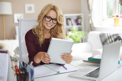 Blonde girl working at home Royalty Free Stock Photos