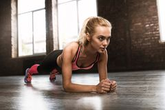 Blonde girl working out at a gym Royalty Free Stock Photo