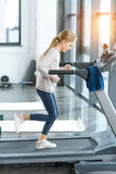 Blonde girl workout on treadmill Stock Image