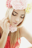 Blonde girl with a wreath of flowers on her head Royalty Free Stock Photos
