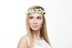 Blonde girl, with a wreath of spring flowers, Stock Images