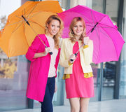 Blonde girls with colorful umbrellas Royalty Free Stock Photos