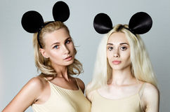 Blonde girls wearing mouse ears Royalty Free Stock Photos