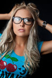 Blonde with glasses Royalty Free Stock Images