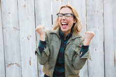 Blonde in glasses shouting and cheering Royalty Free Stock Photography
