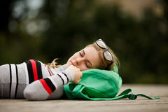 Blonde with glasses is sleeping outdoors Stock Photography