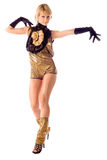 Blonde go-go girl in gold costume isolated Royalty Free Stock Photo