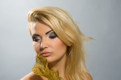 Blonde with golden calla lily 1 Stock Photography