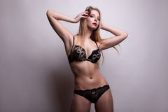 Blonde with gorgeous body and big boobs on grey background Stock Images