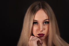 A Blonde gothic priestess in the dark Royalty Free Stock Photography