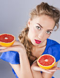 Blonde with Grapefruit,red lipstick Stock Images