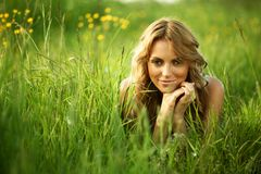 Blonde on grass Stock Photography
