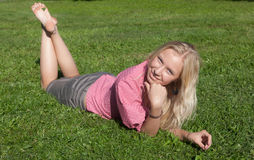 The blonde on a grass Royalty Free Stock Image