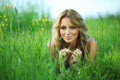 Blonde on grass Royalty Free Stock Images