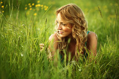 Blonde on grass Royalty Free Stock Photography