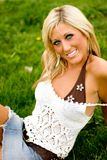Blonde in the Grass Royalty Free Stock Photography