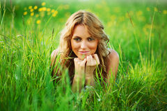 Blonde on grass stock image