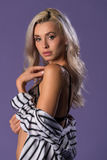 Blonde in gray and white Royalty Free Stock Photography
