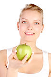 Blonde with green apple Royalty Free Stock Photos
