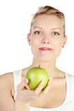 Blonde with green apple Royalty Free Stock Images