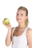 Blonde with green apple Royalty Free Stock Photo