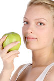 Blonde with green apple Stock Photo