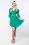 Blonde in green dress Stock Image