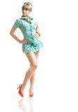 Blonde in groene kleding royalty-vrije stock foto