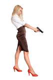 Blonde with a gun Stock Photo